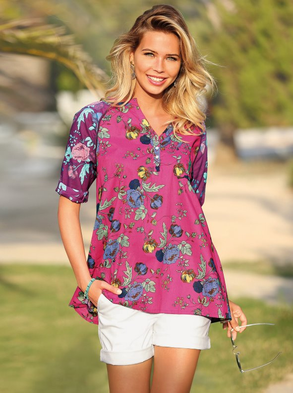 Women's evasé blouse with 3/4 sleeves and floral print ended in a soft voilé