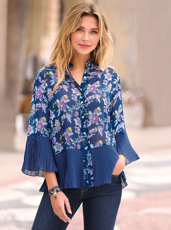 Print blouse with contrasting pleated fabric on cuffs and hem
