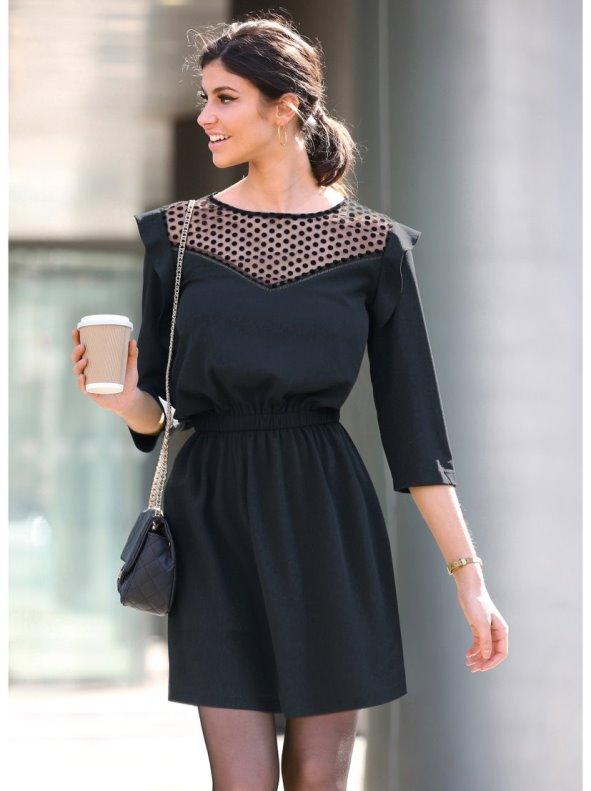 Women's dress with semitransparent yoke and elastic waist cut.