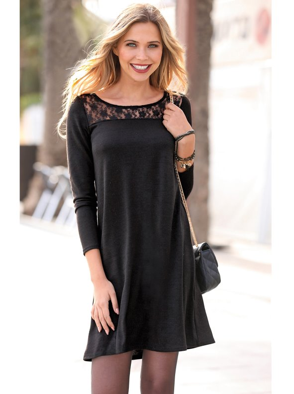 Women's evasé dress with blonde yoke on the front and back.