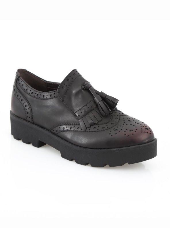 Zapatos de mujer tipo mocasines con borlas inspiración masculina