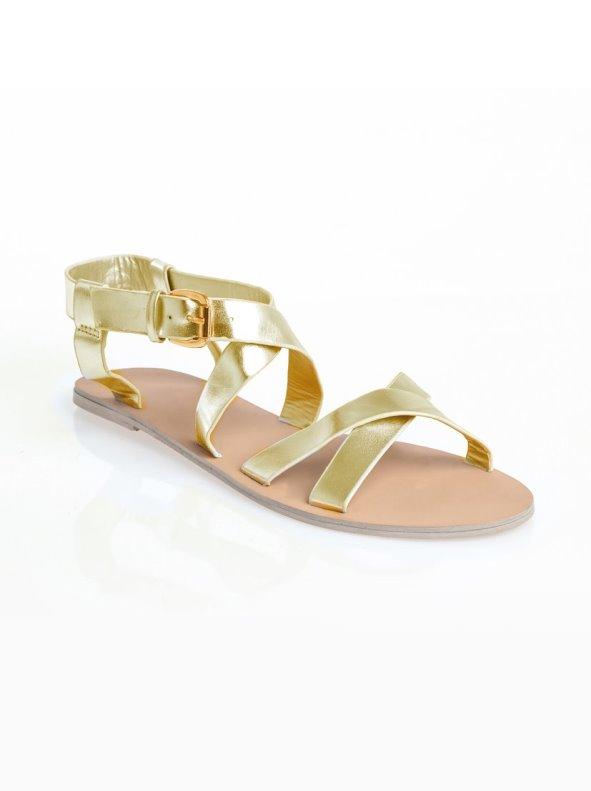 Sandalias planas de mujer con tiras cruzadas de acabado metalizado